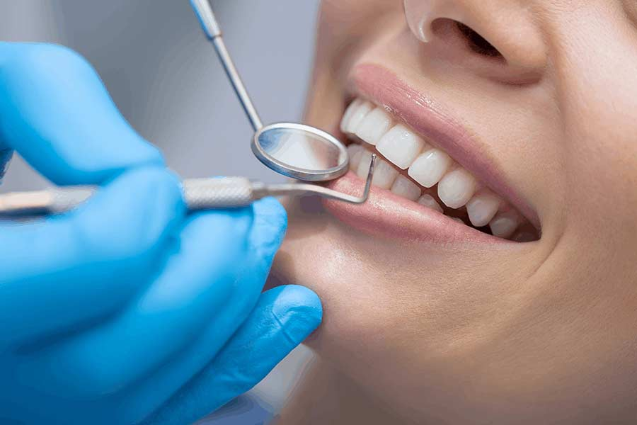 Patient receiving a routine cleaning from a dentist