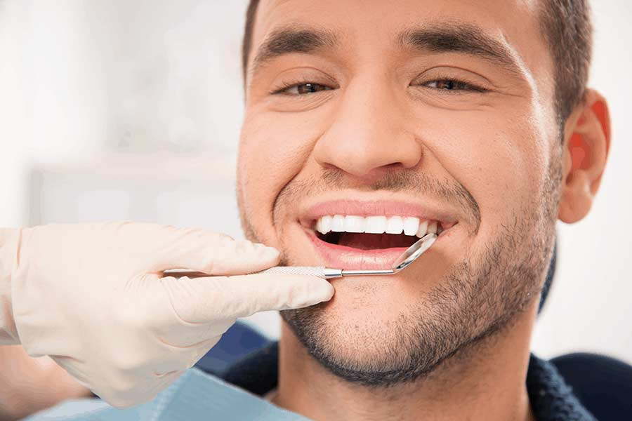 Patient relieved after visiting the dentist for emergency care