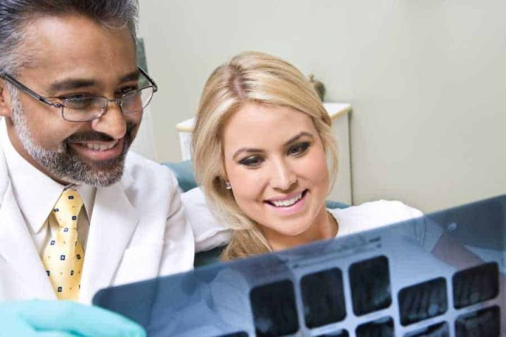 San Marcos dentist and patient looking at x-rays